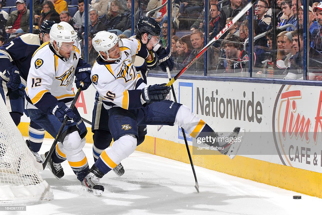 <a gi-track='captionPersonalityLinkClicked' href=/galleries/search?phrase=Martin+Erat&family=editorial&specificpeople=210561 ng-click='$event.stopPropagation()'>Martin Erat</a> #10 of the Nashville Predators and <a gi-track='captionPersonalityLinkClicked' href=/galleries/search?phrase=Ryan+Johansen&family=editorial&specificpeople=6698841 ng-click='$event.stopPropagation()'>Ryan Johansen</a> #19 of the Columbus Blue Jackets battle for a loose puck during the second period on March 19, 2013 at Nationwide Arena in Columbus, Ohio.