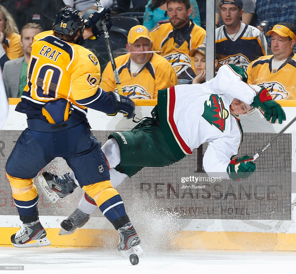 <a gi-track='captionPersonalityLinkClicked' href=/galleries/search?phrase=Martin+Erat&family=editorial&specificpeople=210561 ng-click='$event.stopPropagation()'>Martin Erat</a> #10 of the Nashville Predators checks Jason Zucker #16 of the Minnesota Wild during an NHL game at the Bridgestone Arena on March 9, 2013 in Nashville, Tennessee.