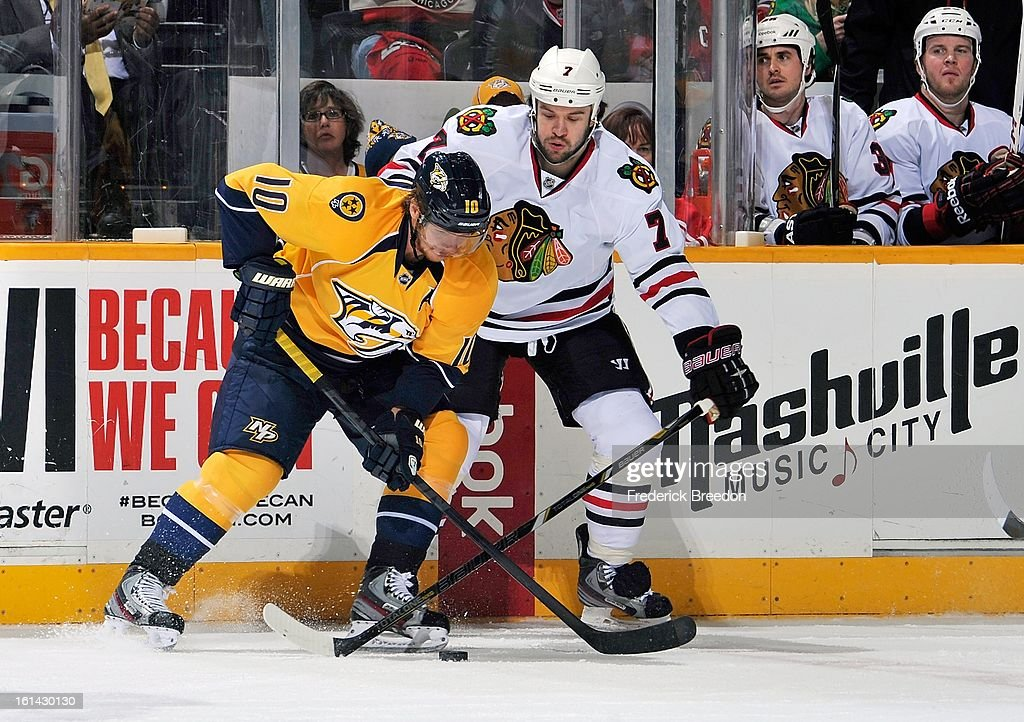 <a gi-track='captionPersonalityLinkClicked' href=/galleries/search?phrase=Martin+Erat&family=editorial&specificpeople=210561 ng-click='$event.stopPropagation()'>Martin Erat</a> #10 of the Nashville Predators skates against <a gi-track='captionPersonalityLinkClicked' href=/galleries/search?phrase=Brent+Seabrook&family=editorial&specificpeople=638862 ng-click='$event.stopPropagation()'>Brent Seabrook</a> #7 of the Chicago Blackhawks at the Bridgestone Arena on February 10, 2013 in Nashville, Tennessee.