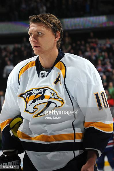 Martin Erat of the Nashville Predators stands for the singing of the national anthem prior to a game against the Edmonton Oilers on March 17 2013 at...