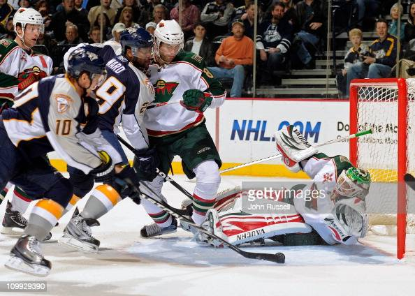 Martin Erat of the Nashville Predators tips a loose puck into the net against Niklas Backstrom of the Minnesota Wild during an NHL game on March 10...