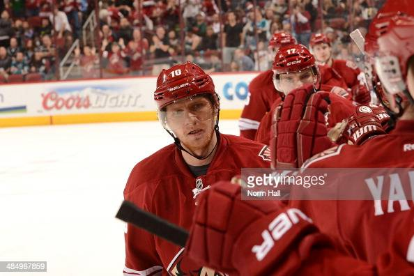 Martin Erat of the Phoenix Coyotes and teammates on the bench celebrate a goal against the San Jose Sharks at Jobingcom Arena on April 12 2014 in...