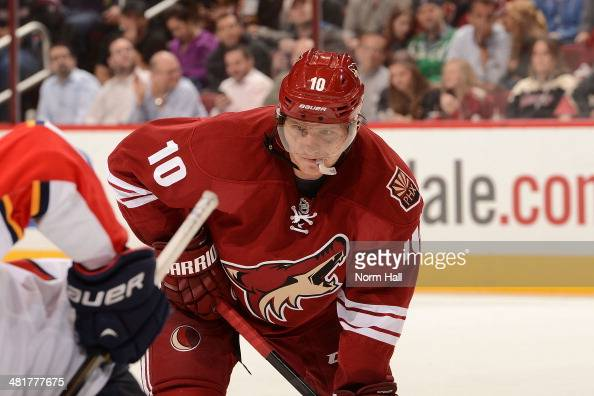 Martin Erat of the Phoenix Coyotes gets ready during a faceoff against the Florida Panthers at Jobingcom Arena on March 20 2014 in Glendale Arizona