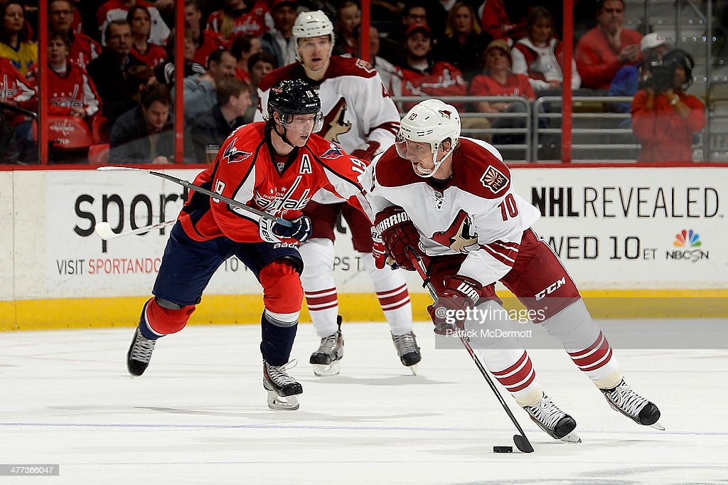 <a gi-track='captionPersonalityLinkClicked' href=/galleries/search?phrase=Martin+Erat&family=editorial&specificpeople=210561 ng-click='$event.stopPropagation()'>Martin Erat</a> #10 of the Phoenix Coyotes moves the puck up ice in the third period during an NHL game against the Washington Capitals at Verizon Center on March 8, 2014 in Washington, DC.