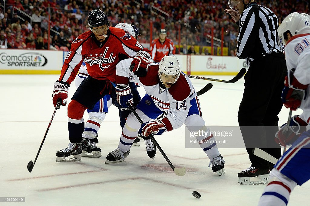 <a gi-track='captionPersonalityLinkClicked' href=/galleries/search?phrase=Martin+Erat&family=editorial&specificpeople=210561 ng-click='$event.stopPropagation()'>Martin Erat</a> #10 of the Washington Capitals and <a gi-track='captionPersonalityLinkClicked' href=/galleries/search?phrase=Tomas+Plekanec&family=editorial&specificpeople=620244 ng-click='$event.stopPropagation()'>Tomas Plekanec</a> #14 of the Montreal Canadiens battle for a face-off during an NHL game at Verizon Center on November 22, 2013 in Washington, DC.
