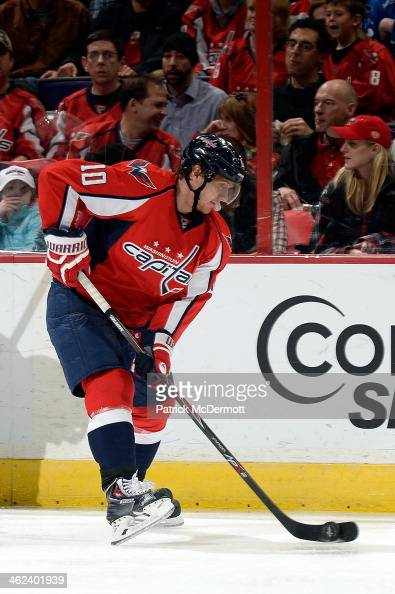 Martin Erat of the Washington Capitals controls the puck in the third period during an NHL game against the Carolina Hurricanes at Verizon Center on...