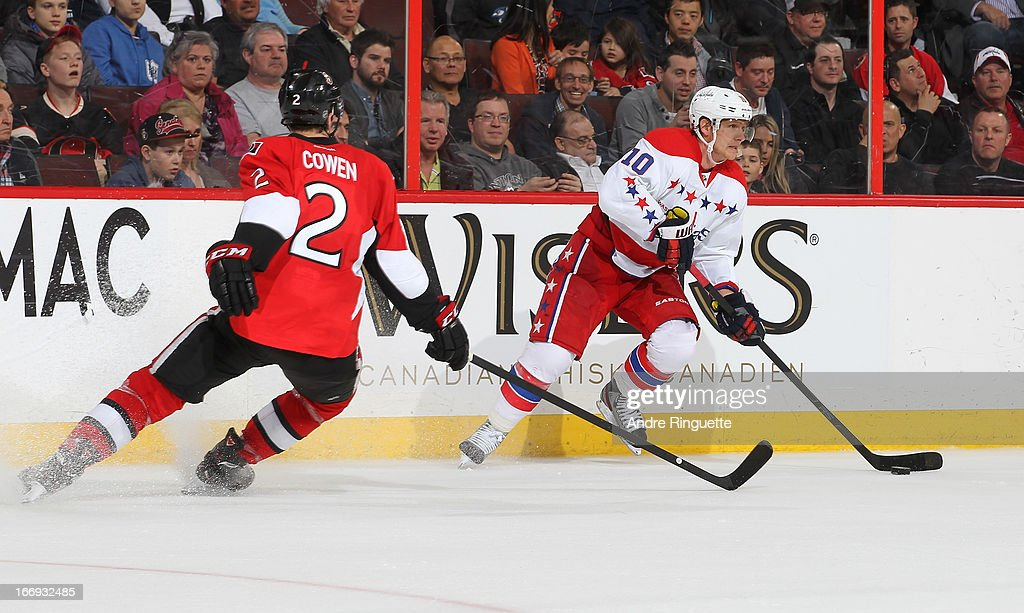 <a gi-track='captionPersonalityLinkClicked' href=/galleries/search?phrase=Martin+Erat&family=editorial&specificpeople=210561 ng-click='$event.stopPropagation()'>Martin Erat</a> #10 of the Washington Capitals looks to pass the puck against <a gi-track='captionPersonalityLinkClicked' href=/galleries/search?phrase=Jared+Cowen&family=editorial&specificpeople=4594191 ng-click='$event.stopPropagation()'>Jared Cowen</a> #2 of the Ottawa Senators on April 18, 2013 at Scotiabank Place in Ottawa, Ontario, Canada.