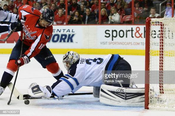 Martin Erat of the Washington Capitals shoots on Ondrej Pavelec of the Winnipeg Jets in the third period during an NHL game at the Verizon Center on...
