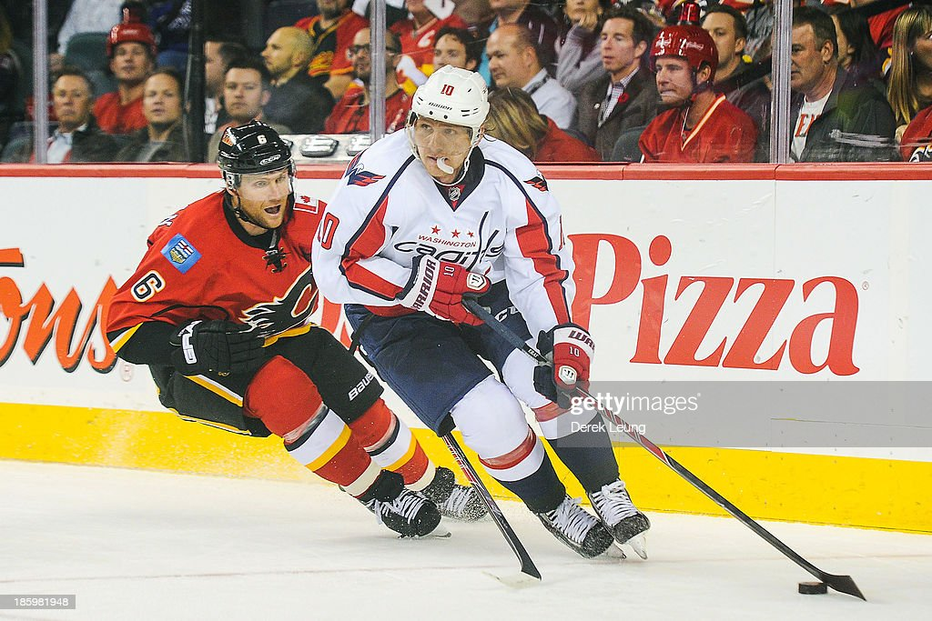 <a gi-track='captionPersonalityLinkClicked' href=/galleries/search?phrase=Martin+Erat&family=editorial&specificpeople=210561 ng-click='$event.stopPropagation()'>Martin Erat</a> #10 of the Washington Capitals skates with the puck past <a gi-track='captionPersonalityLinkClicked' href=/galleries/search?phrase=Dennis+Wideman&family=editorial&specificpeople=575234 ng-click='$event.stopPropagation()'>Dennis Wideman</a> #6 of the Calgary Flames during an NHL game at Scotiabank Saddledome on October 26, 2013 in Calgary, Alberta, Canada.