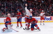 Martin Erat Troy Brouwer and Brooks Laich of the Washington Capitals celebrate a goal scored by John Erskine against the Montreal Canadiens during...