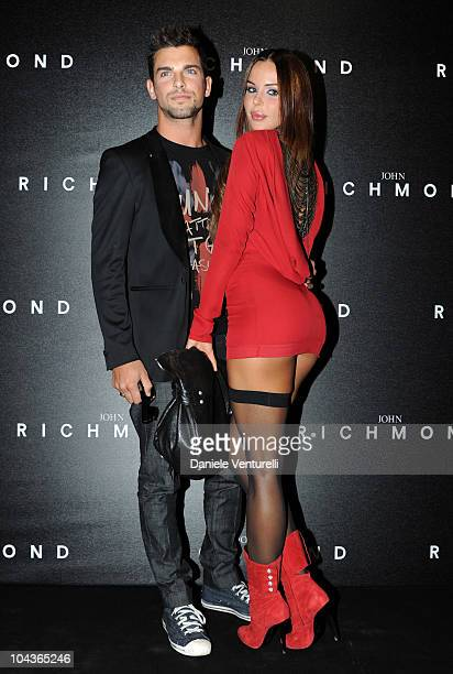 Martin Evans and Nina Moric attend the John Richmond Milan Fashion Week Womenswear S/S 2011 show on September 22 2010 in Milan Italy
