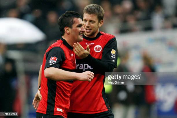 Martin Fenin of Frankfurt celebrates with team mate Marco Russ after the Bundesliga match between Eintracht Frankfurt and Bayern Muenchen at the...