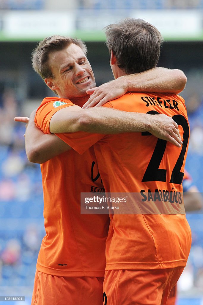 Martin Forkel (L) and Manuel Stiefler of Saarbruecken celebrate their teams first goal during the Third League match between Arminia Bielefeld and 1. FC Saarbruecken at the Schueco Arena on September 17, 2011 in Bielefeld, Germany.