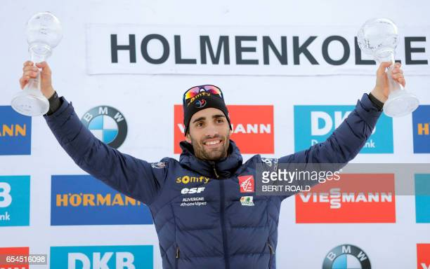 Martin Fourcade from France celebrates with the trophies for overall victory in the men`s individual and sprint cup after the IBU Biathlon World Cup...