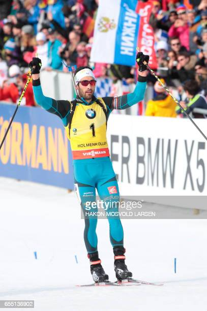 Martin Fourcade from France crosses the finish line in IBU Biathlon World Cup Men 15 km Mass Start competition in Oslo on March 19 2017 / AFP PHOTO /...