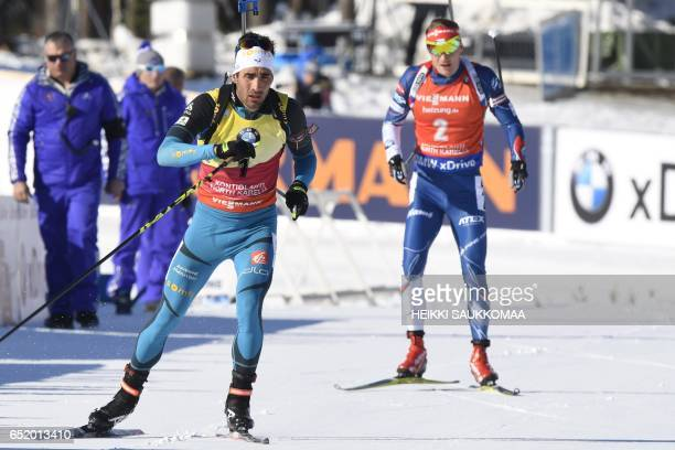 Martin Fourcade of France and Czech Republic's Ondrej Moravec compete during the men's 125 km pursuit at the IBU Biathlon World Cup in Kontiolahti...