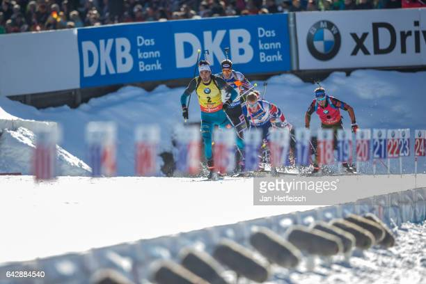 Martin Fourcade of France and Simon Schempp of Germany in action at the men's 15km mass start competition during the IBU World Championships Biathlon...