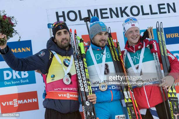 Martin Fourcade of France Anton Shipulin of Russia and Johannes Thingnes Boe of Norway celebrate during the 15 km men's Mass Start on March 18 2017...