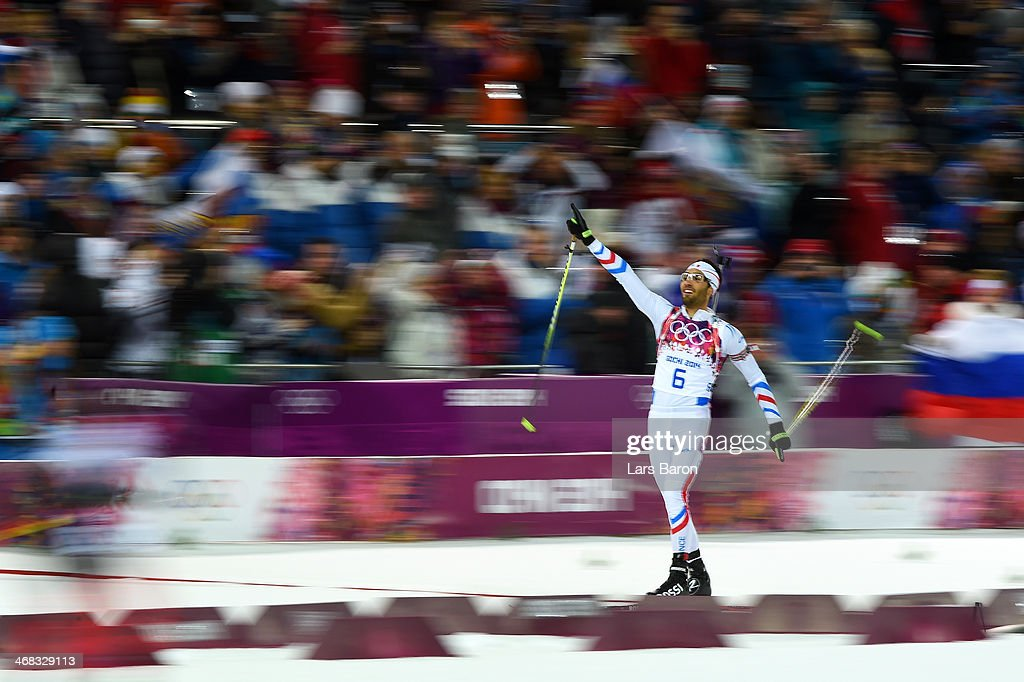 <a gi-track='captionPersonalityLinkClicked' href=/galleries/search?phrase=Martin+Fourcade&family=editorial&specificpeople=5656850 ng-click='$event.stopPropagation()'>Martin Fourcade</a> of France blows a kiss as he approaches the finish line to win the Men's 12.5 km Pursuit during day three of the Sochi 2014 Winter Olympics at Laura Cross-country Ski & Biathlon Center on February 10, 2014 in Sochi, Russia.