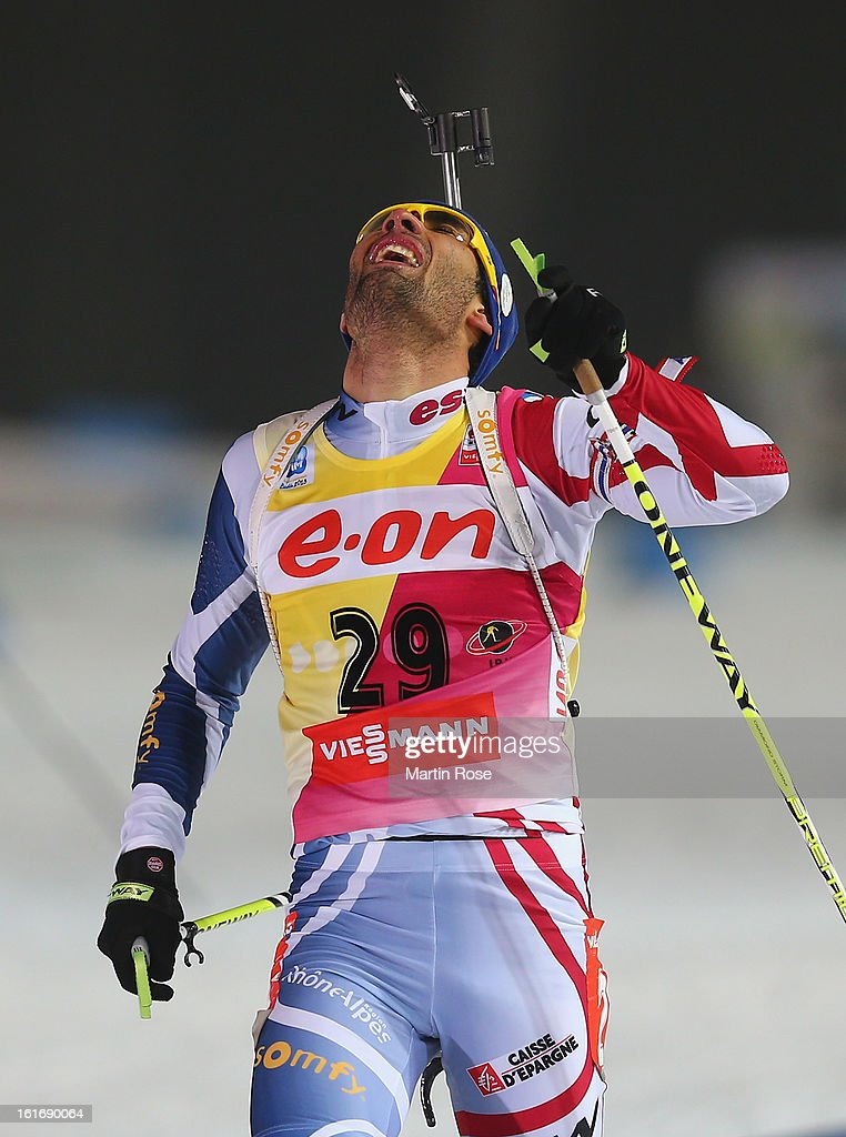 Martin Fourcade of France celebrates after crossing the finish line in the Men's 20km Individual during the IBU Biathlon World Championships at Vysocina Arena on February 14, 2013 in Nove Mesto na Morave, Czech Republic.