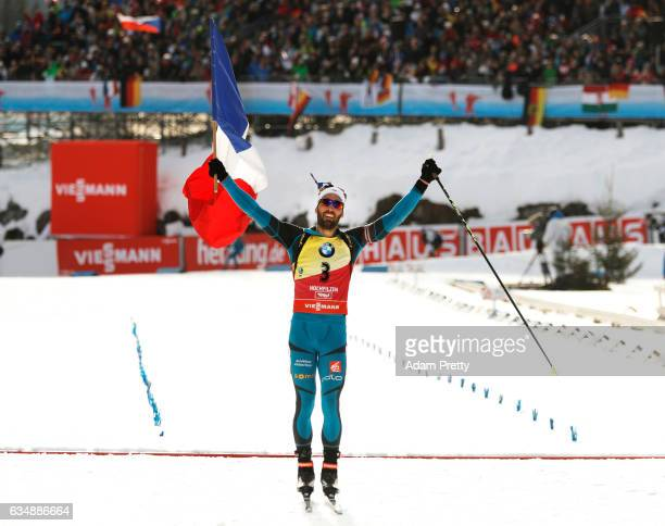Martin Fourcade of France celebrates after winning gold in the Men's 125km pursuit competition of the IBU World Championships Biathlon 2017 at the...