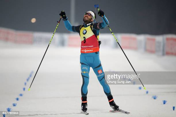 Martin Fourcade of France celebrates after winning in the Men 125km Pursuit during the BMW IBU World Cup Biathlon 2017 a test event for PyeongChang...