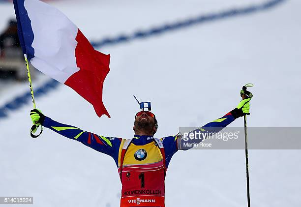 Martin Fourcade of France celebrates after winning the gold medal in the men's 125km pursuit during day four of the IBU Biathlon World Championships...