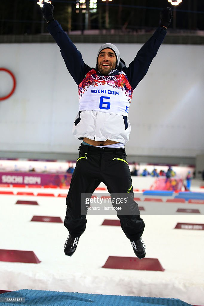 <a gi-track='captionPersonalityLinkClicked' href=/galleries/search?phrase=Martin+Fourcade&family=editorial&specificpeople=5656850 ng-click='$event.stopPropagation()'>Martin Fourcade</a> of France celebrates during the flower ceremony of the Men's 12.5 km Pursuit during day three of the Sochi 2014 Winter Olympics at Laura Cross-country Ski & Biathlon Center on February 10, 2014 in Sochi, Russia.