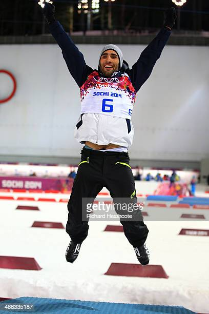 Martin Fourcade of France celebrates during the flower ceremony of the Men's 125 km Pursuit during day three of the Sochi 2014 Winter Olympics at...