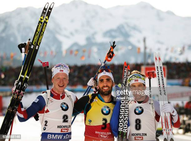 Martin Fourcade of France celebrates winning gold Johannes Thingnes Boe of Norway celebrates silver and Ole Einer Bjoerndalen of Norway celebrates...