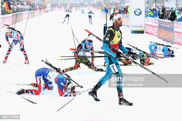 Martin Fourcade of France celebrates winning the 125 km Men's Pursuit at the finish area during the IBU Biathlon World Cup at Chiemgau Arena on...