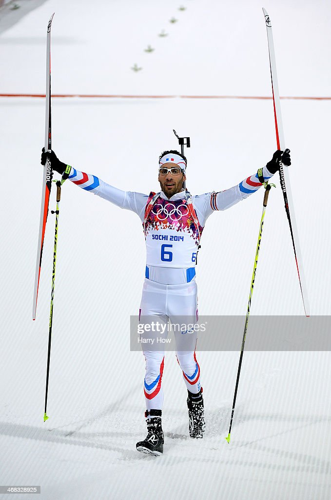 <a gi-track='captionPersonalityLinkClicked' href=/galleries/search?phrase=Martin+Fourcade&family=editorial&specificpeople=5656850 ng-click='$event.stopPropagation()'>Martin Fourcade</a> of France celebrates winning the Men's 12.5 km Pursuit during day three of the Sochi 2014 Winter Olympics at Laura Cross-country Ski & Biathlon Center on February 10, 2014 in Sochi, Russia.