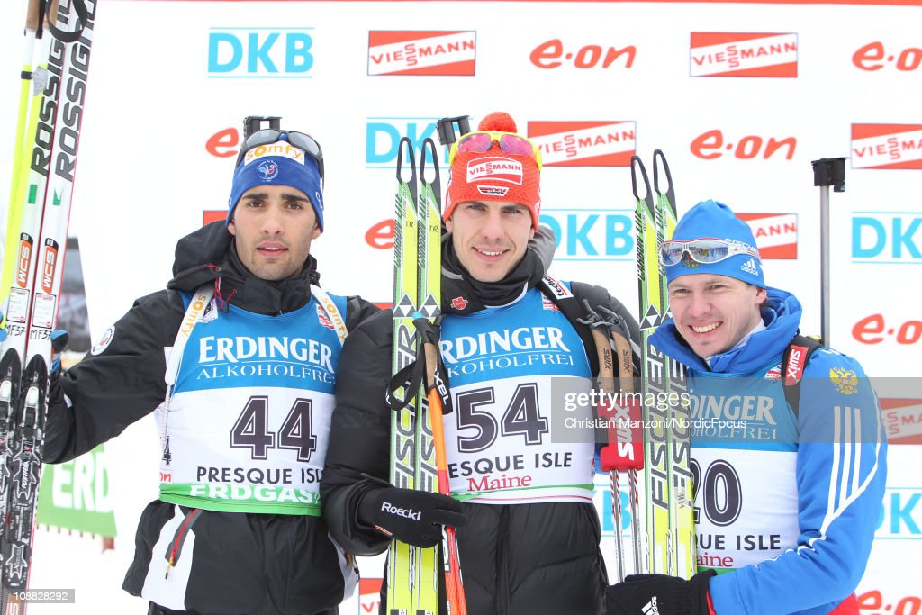 Martin Fourcade of France celebrates with Arnd Peiffer of Germany and Ivan Tcherezov of Russia after the men's sprint during the EON IBU Biathlon...