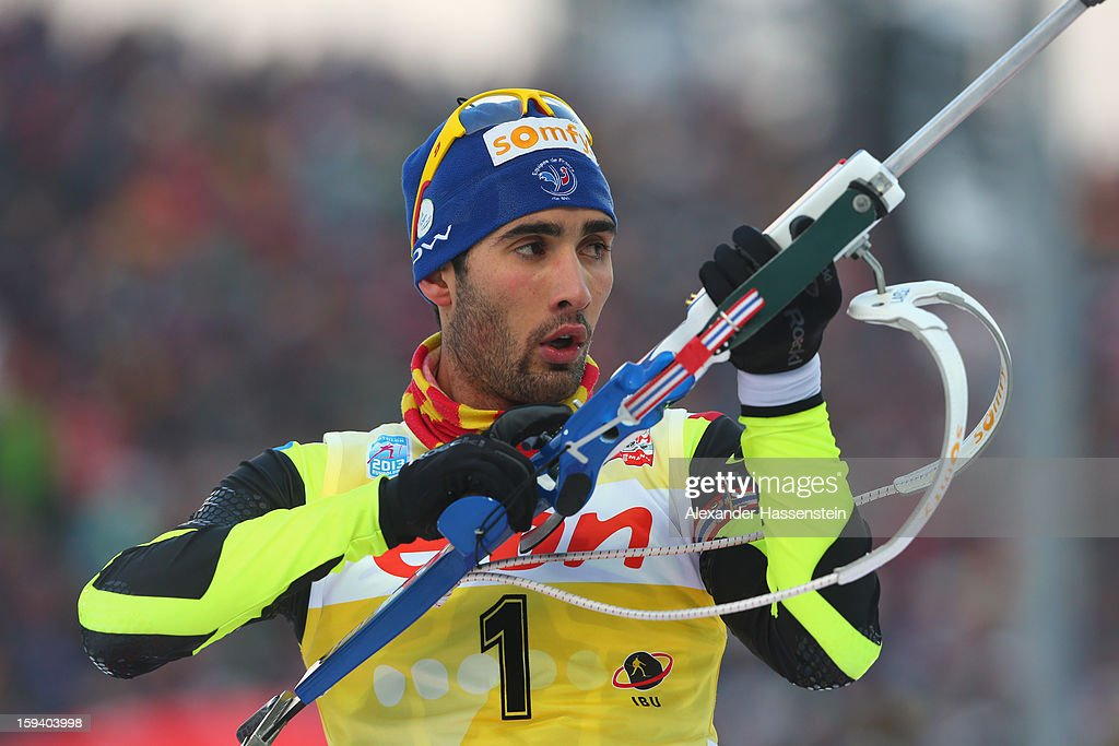 <a gi-track='captionPersonalityLinkClicked' href=/galleries/search?phrase=Martin+Fourcade&family=editorial&specificpeople=5656850 ng-click='$event.stopPropagation()'>Martin Fourcade</a> of France competes at the men's 15km mass start event during the IBU Biathlon World Cup at Chiemgau Arena on January 13, 2013 in Ruhpolding, Germany.