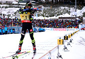 Martin Fourcade of France competes at the shooting range during the Men's 15 km mass start of the BMW World Cup on January 11 2015 in Oberhof Germany