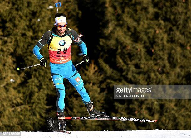 Martin Fourcade of France competes during the Biathlon World Cup Men's 20km individual race in Anterselva on January 20 2017 Anton Shipulin of Russia...