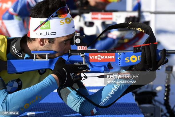 Martin Fourcade of France competes during the men's 125 km pursuit at the IBU Biathlon World Cup in Kontiolahti Finland on March 11 2017 / AFP PHOTO...