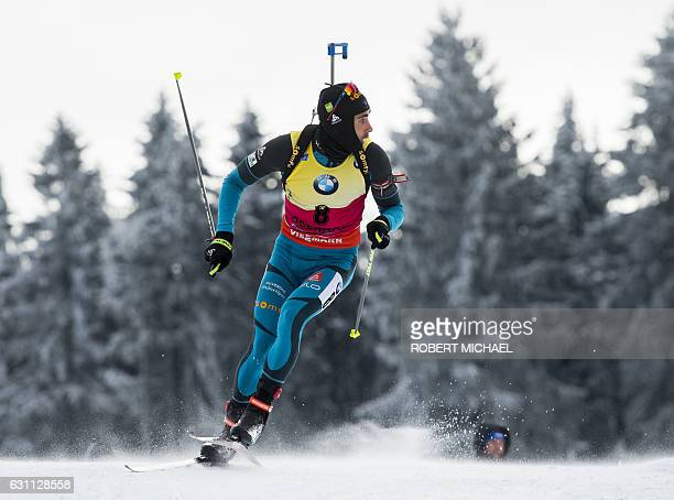 Martin Fourcade of France competes in the men's 125 km pursuit race of the IBU Biathlon World Cup in Oberhof eastern Germany on January 7 2017 / AFP...