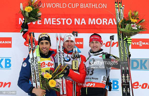 Martin Fourcade of France Emil Hegle Svendsen of Norway and Jakov Fak of Czech Republic celebrate after men's 10km sprint event during the IBU...