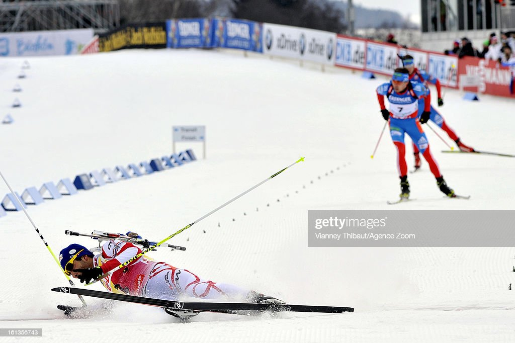 Martin Fourcade of France falls to the track as he crosses the finish line and takes 2nd place ahead of Anton Shipulin of Russia in 3rd place during the IBU Biathlon World Championship Men's 12.5km Pursuit on February 10, 2013 in Nove Mesto, Czech Republic.