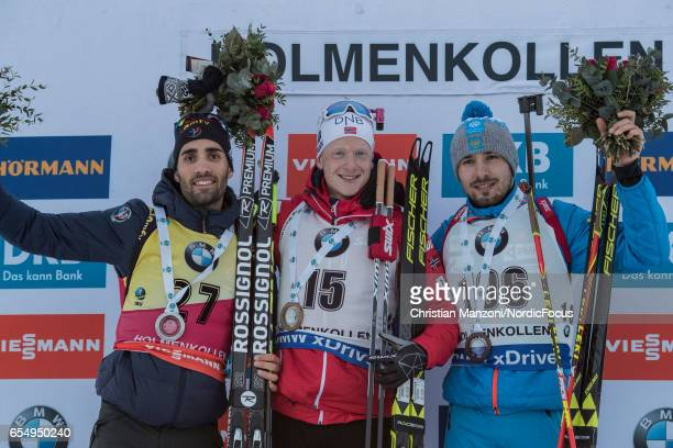 Martin Fourcade of France Johannes Thingnes Boe of Norway and Anton Shipulin of Russia celebrate after the 125 km men's Pursuit on March 17 2017 in...