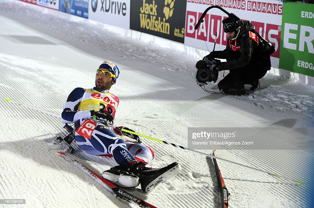 Martin Fourcade of France lies on the ground after taking first place during the IBU Biathlon World Championship Men's 20km Individual on February 14, 2013 in Nove Mesto, Czech Republic.