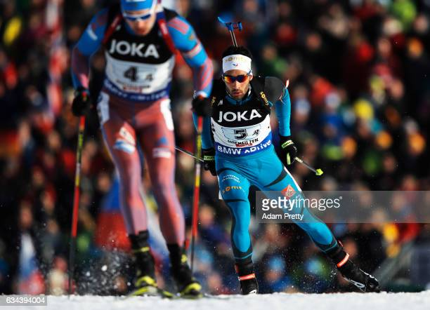 Martin Fourcade of France looks to overtake Anton Shipulin of Russia in the Mixed Relay competition of the IBU World Championships Biathlon 2017 at...