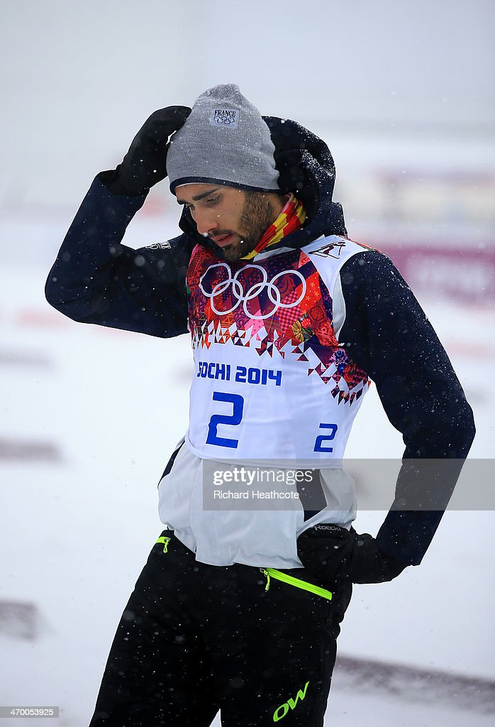 <a gi-track='captionPersonalityLinkClicked' href=/galleries/search?phrase=Martin+Fourcade&family=editorial&specificpeople=5656850 ng-click='$event.stopPropagation()'>Martin Fourcade</a> of France reacts during the flower ceremony for the Men's 15 km Mass Start during day 11 of the Sochi 2014 Winter Olympics at Laura Cross-country Ski & Biathlon Center on February 18, 2014 in Sochi, Russia.