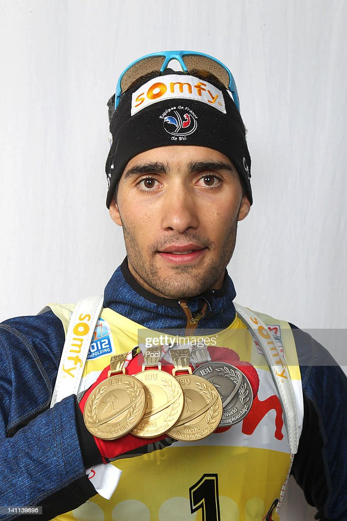 <a gi-track='captionPersonalityLinkClicked' href=/galleries/search?phrase=Martin+Fourcade&family=editorial&specificpeople=5656850 ng-click='$event.stopPropagation()'>Martin Fourcade</a> of France shows his medal of the IBU Biathlon World Championships Men's Mass Start on March 11, 2012 in Ruhpolding, Germany.