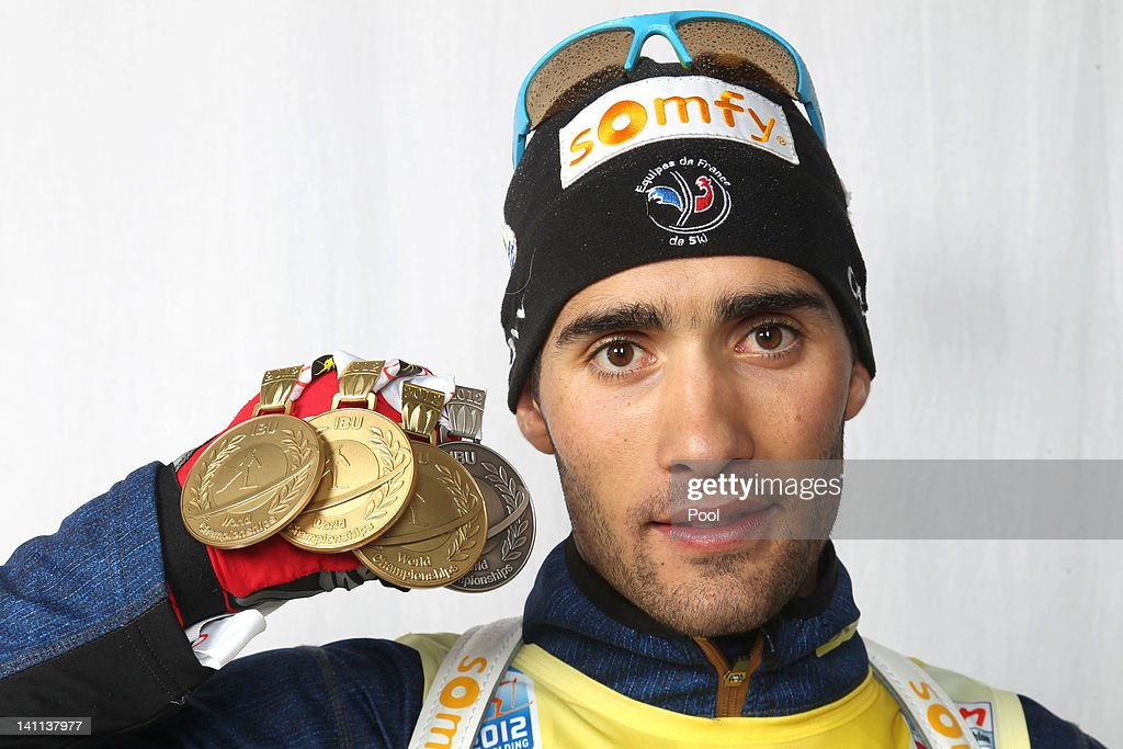 <a gi-track='captionPersonalityLinkClicked' href=/galleries/search?phrase=Martin+Fourcade&family=editorial&specificpeople=5656850 ng-click='$event.stopPropagation()'>Martin Fourcade</a> of France shows his medals of the IBU Biathlon World Championships Men's Mass Start on March 11, 2012 in Ruhpolding, Germany. (Photo by Christian Manzoni/IBU-Pool/Getty Images).