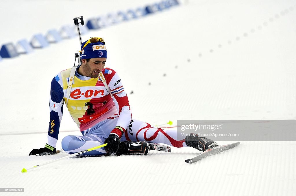 Martin Fourcade of France sits on the track past the finish line as he takes 2nd place during the IBU Biathlon World Championship Men's 12.5km Pursuit on February 10, 2013 in Nove Mesto, Czech Republic.