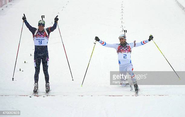 Martin Fourcade of France stretches for the finish line next to Emil Hegle Svendsen of Norwaycompetes in the Men's 15 km Mass Start during day 11 of...
