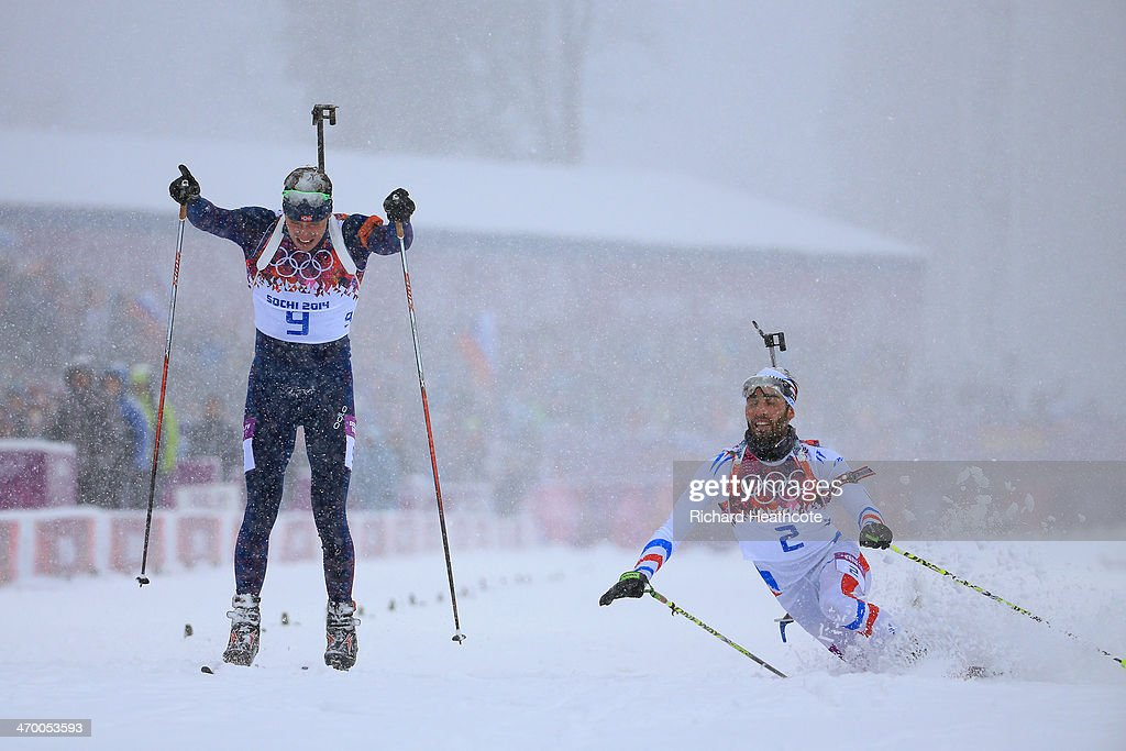 <a gi-track='captionPersonalityLinkClicked' href=/galleries/search?phrase=Martin+Fourcade&family=editorial&specificpeople=5656850 ng-click='$event.stopPropagation()'>Martin Fourcade</a> of France stretches for the finish line next to <a gi-track='captionPersonalityLinkClicked' href=/galleries/search?phrase=Emil+Hegle+Svendsen&family=editorial&specificpeople=831528 ng-click='$event.stopPropagation()'>Emil Hegle Svendsen</a> of Norway during the Men's 15 km Mass Start during day 11 of the Sochi 2014 Winter Olympics at Laura Cross-country Ski & Biathlon Center on February 18, 2014 in Sochi, Russia.