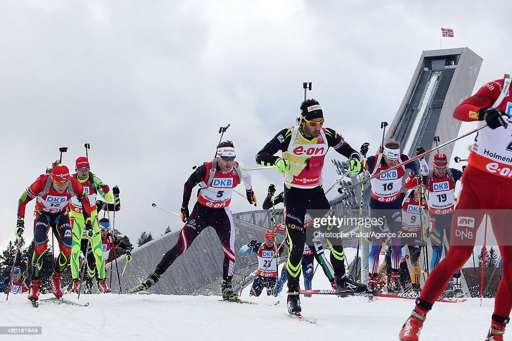 Martin Fourcade of France takes 1st place and wins the World Cup globe during the IBU Biathlon World Cup Men's and Women's Mass Start on March 23...